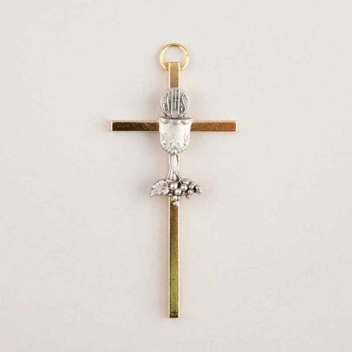 golden metal cross and silver chalice